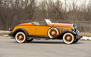 Фотография Ретро Кабриолет Желтый Металлик Сбоку Родстер 1931 Hudson Greater Eight Sport Roadster Автомобили