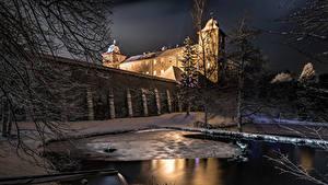 Фото Германия Зимние Замки Вечер Пруд Снег Ограда Castle Schnellenberg Города