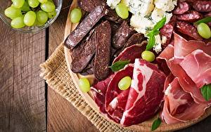 Фотография Ветчина Колбаса Мясные продукты Нарезанные продукты Продукты питания