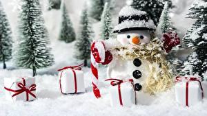 Фотография Леденцы Подарки Снеговики Шляпа Снег
