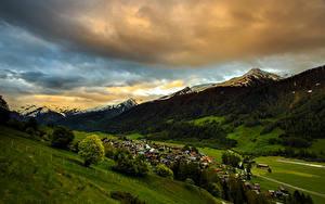 Обои Швейцария Пейзаж Горы Дома Поля Леса Облако Munster Goms Природа
