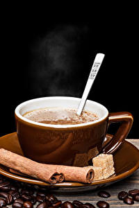 Картинка Напиток Кофе Корица Черный фон Чашка Зерна Еда