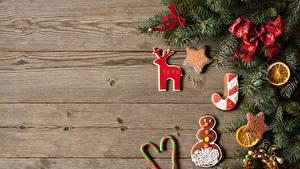 Картинки Новый год Печенье Сладости Доски Ветка Дизайна Бант