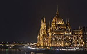 Фотографии Венгрия Будапешт Дома Реки Мосты Ночь