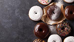 Фотография Пончики Шоколад Выпечка Сахарная пудра