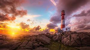 Фото Норвегия Берег Рассветы и закаты Маяки Камень Небо Облака Nymark Rogaland Природа