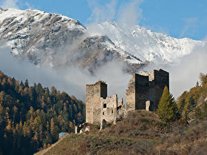 Фотографии Швейцария Горы Лес Замки Развалины Снеге Туман Chanov Castle, Graubünden Природа