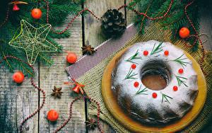 Картинка Рождество Выпечка Сахарная пудра Доски Шарики Шишки
