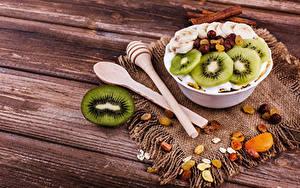 Фотография Мюсли Киви Изюм Доски Завтрак Ложки Еда