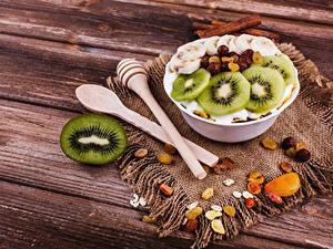 Фотография Мюсли Киви Изюм Доски Завтрак Ложка