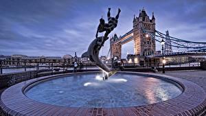 Картинки Англия Фонтаны Дельфины Лондон Уличные фонари Tower Bridge