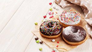 Картинка Выпечка Пончики Шоколад Сладости Доски Трое 3 Продукты питания