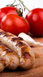 Картинки Мясные продукты Сосиска Помидоры Еда