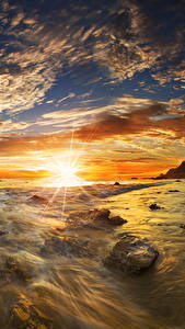 Фотография США Берег Рассветы и закаты Пейзаж Камень Небо Облака Солнце Matador State Beach Malibu Природа