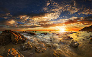 Фотография США Побережье Рассвет и закат Пейзаж Камни Небо Облака Солнце Matador State Beach Malibu Природа