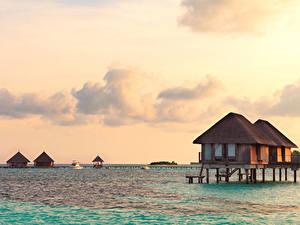 Фото Мальдивы Тропики Море Рассветы и закаты Бунгало