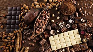 Обои Сладости Шоколад Орехи Конфеты Какао порошок