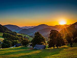 Картинка Германия Гора Рассветы и закаты Здания Солнца Деревьев Landscape Belchen Природа