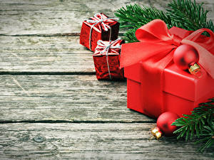 Фотографии Рождество Доски Ветки Подарки Шарики Бантик
