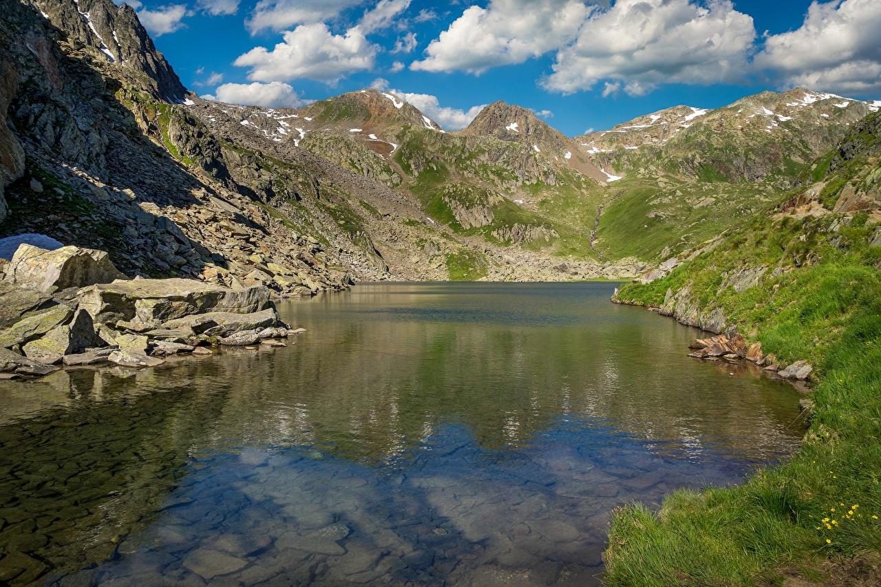 Фото Швейцария Tomasee, Piz Badus Горы Природа Озеро Камень гора Камни