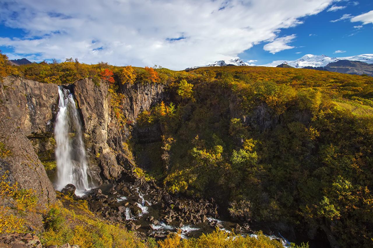 Фотография Исландия Skaftafell National Park Утес Осень Природа Водопады Камни Кусты Скала осенние Камень