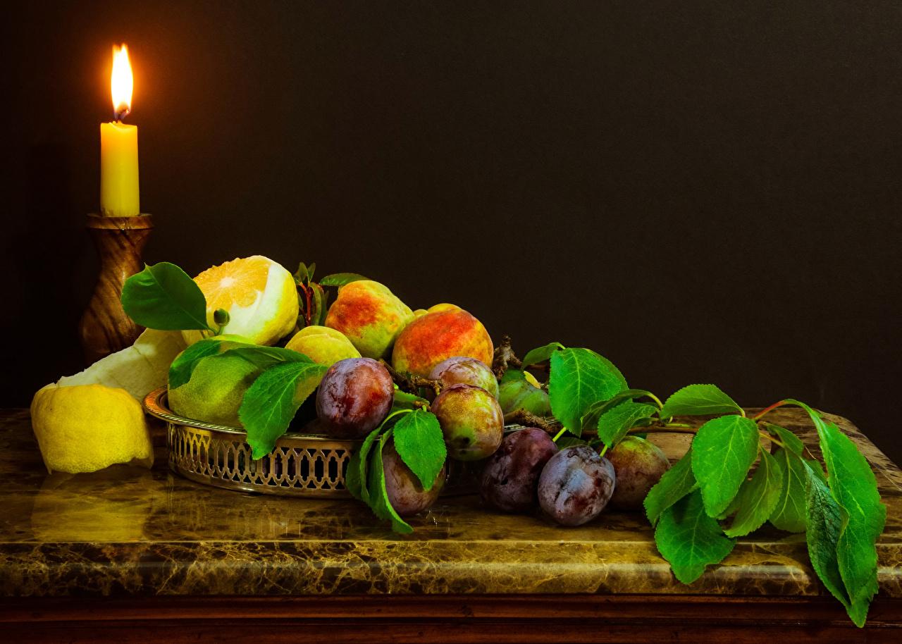 Картинки Сливы Лимоны Пища Свечи Фрукты Еда Продукты питания