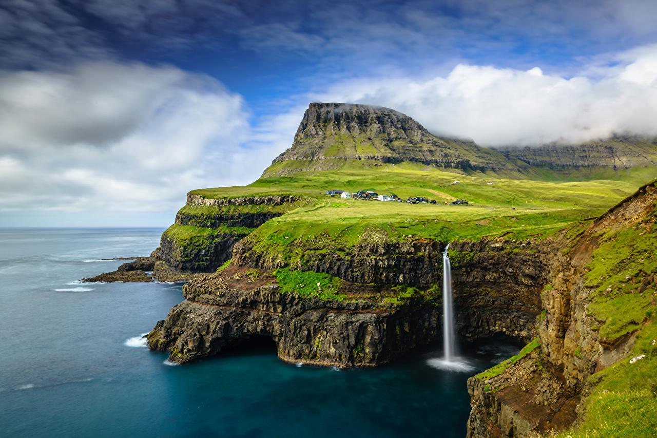 Фотографии Дания Gásadalur, Vágar, Faroe Islands Скала Природа Водопады Небо Остров Облака Утес скале скалы облако облачно