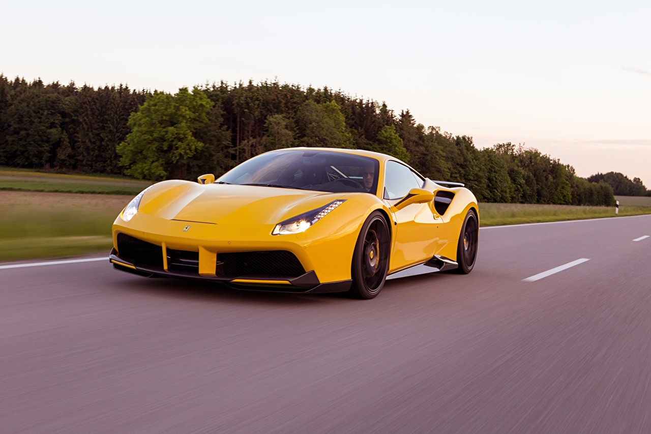 Фото Ferrari Novitec Rosso 488 GTB желтая едущий Автомобили Феррари желтых желтые Желтый едет едущая скорость Движение авто машина машины автомобиль