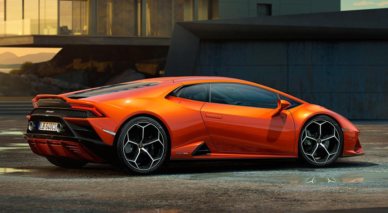 Картинка Ламборгини Huracan EVO, 2019 Купе оранжевая Сбоку машины Lamborghini Оранжевый оранжевые оранжевых авто машина Автомобили автомобиль