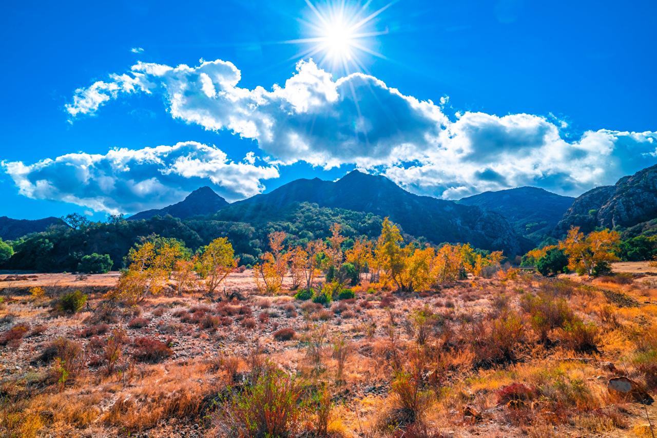 Фотография калифорнии штаты Malibu Creek State Park Горы Солнце Природа парк Пейзаж Облака Калифорния США америка гора солнца Парки облако облачно