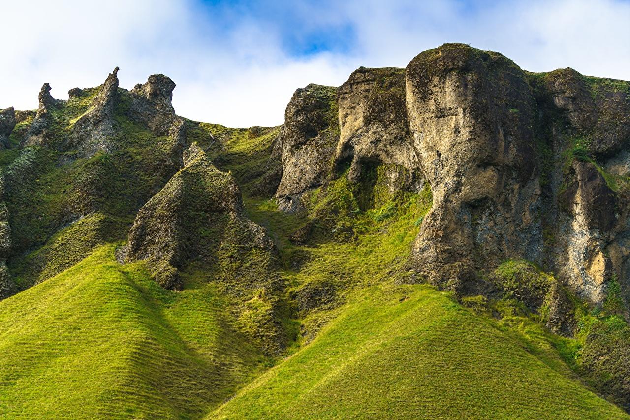 Обои для рабочего стола Исландия Trolls of Foss Горы скалы Природа гора Утес скале Скала