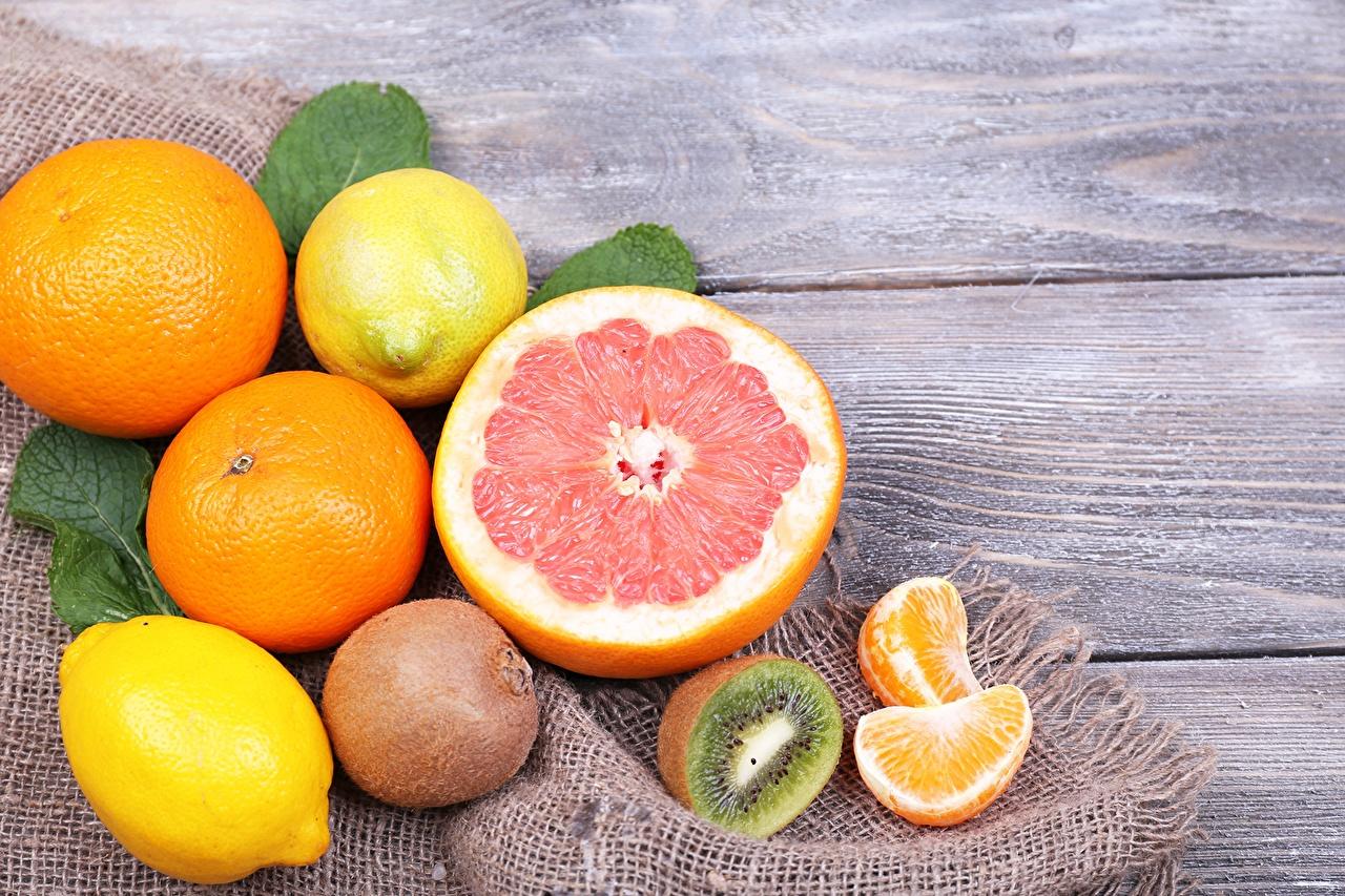 Картинка Мандарины Грейпфрут Киви Лимоны Еда Цитрусовые Доски Пища Продукты питания