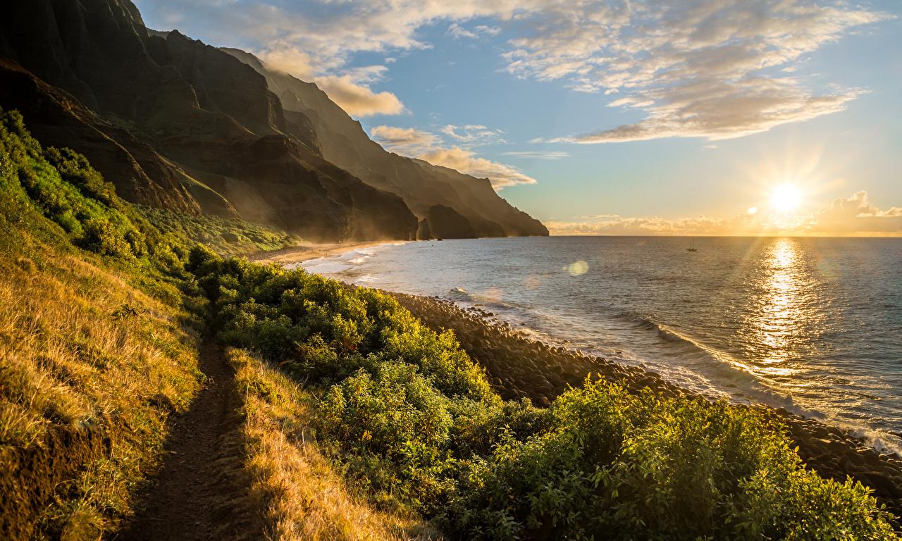 Фотография Гавайи Kalalau Горы Океан солнца Природа Пейзаж Рассветы и закаты берег Облака гавайские острова Солнце Побережье облако облачно