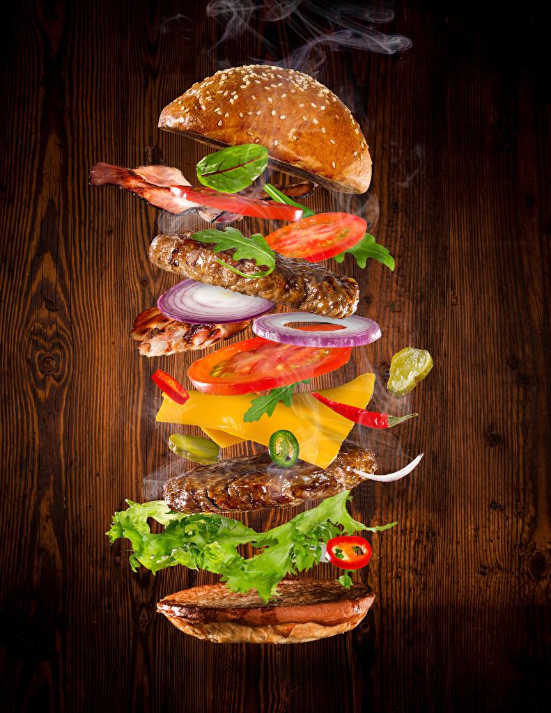 Фотографии Гамбургер Булочки Быстрое питание Овощи Продукты питания Мясные продукты  для мобильного телефона Фастфуд Еда Пища