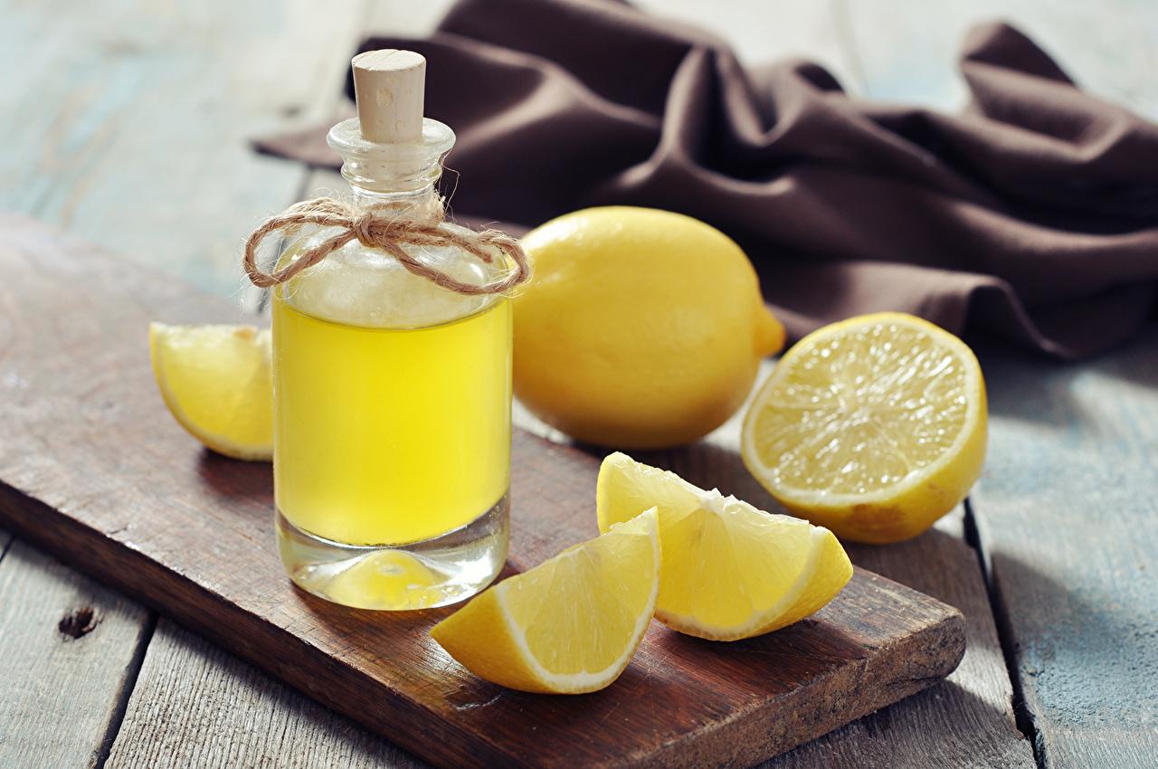 Картинки Сок Лимоны Бутылка Продукты питания Крупным планом Напитки Еда Пища бутылки вблизи напиток
