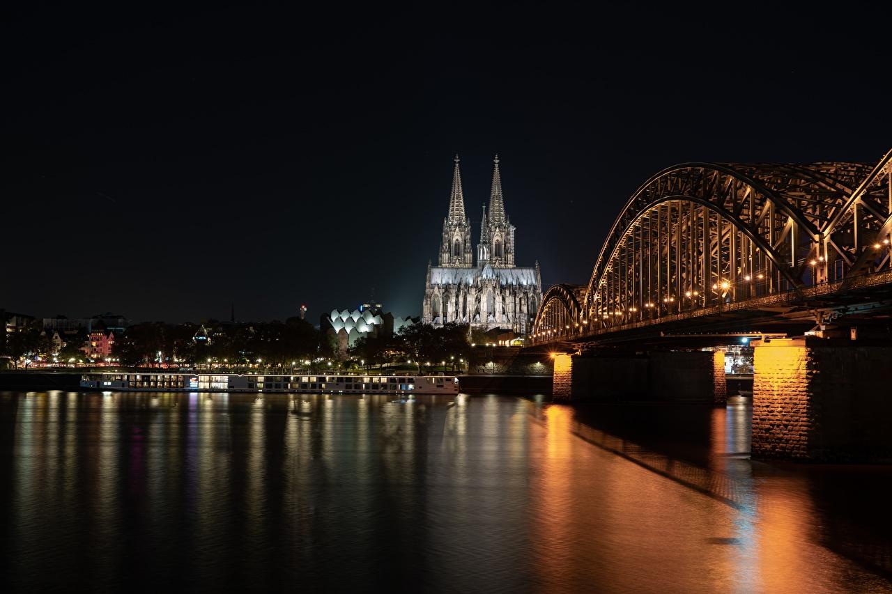 Картинки Кёльн Собор Германия Cologne cathedral, Rhine river мост речка Ночные город Мосты Реки река Ночь ночью в ночи Города