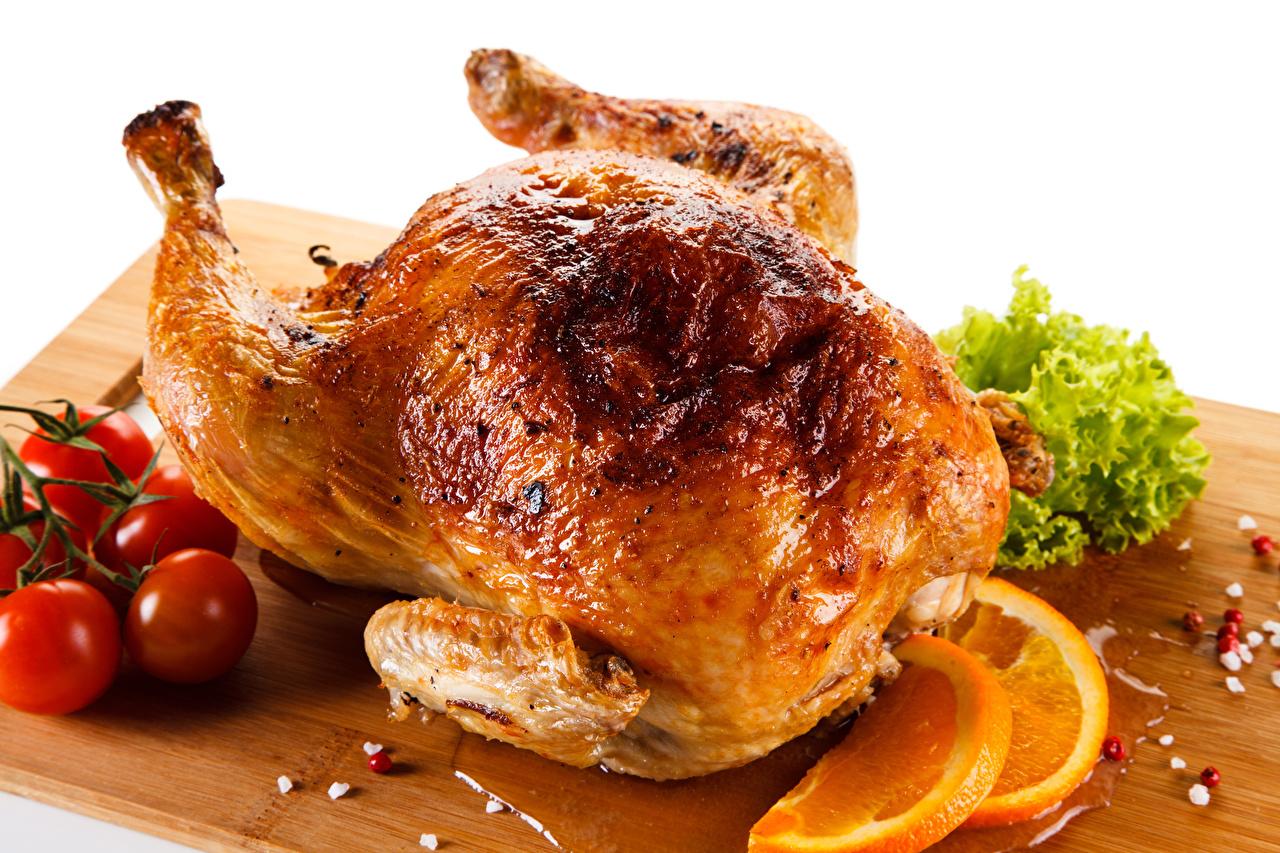 Фотография Томаты Курица запеченная Еда Разделочная доска Цитрусовые Помидоры Пища Продукты питания