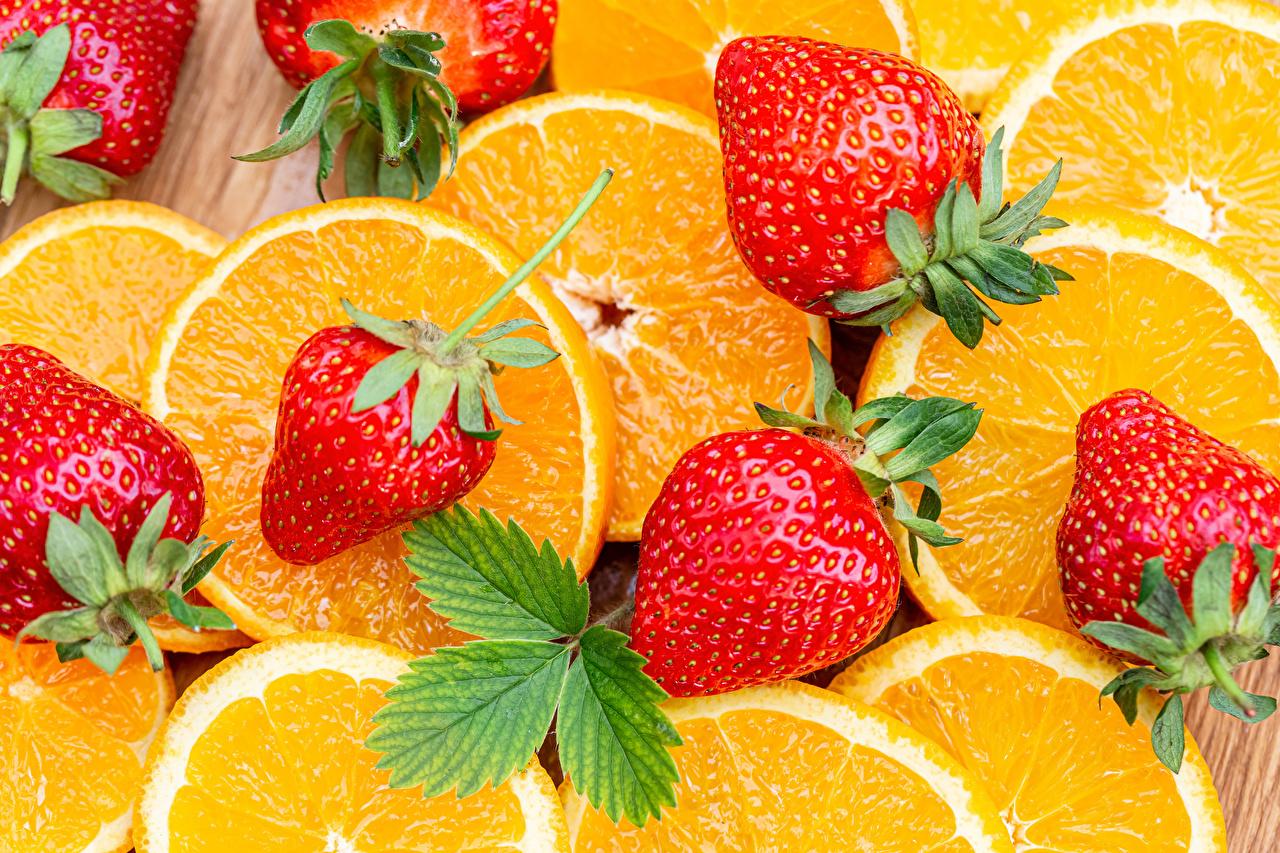 Картинки Апельсин Клубника Продукты питания вблизи Еда Пища Крупным планом
