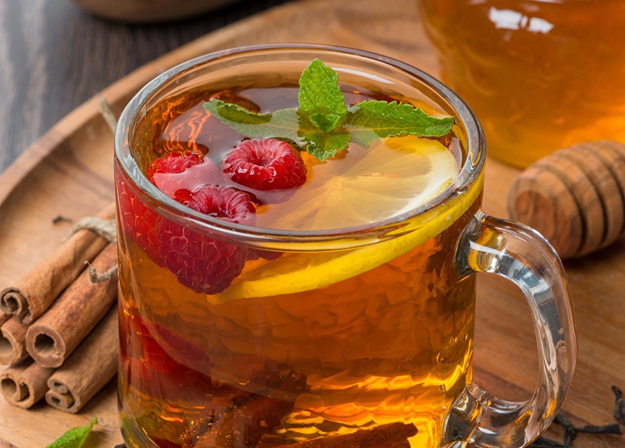 Фото Чай Малина Лимоны Корица Пища Чашка Крупным планом напиток Еда чашке Продукты питания вблизи Напитки