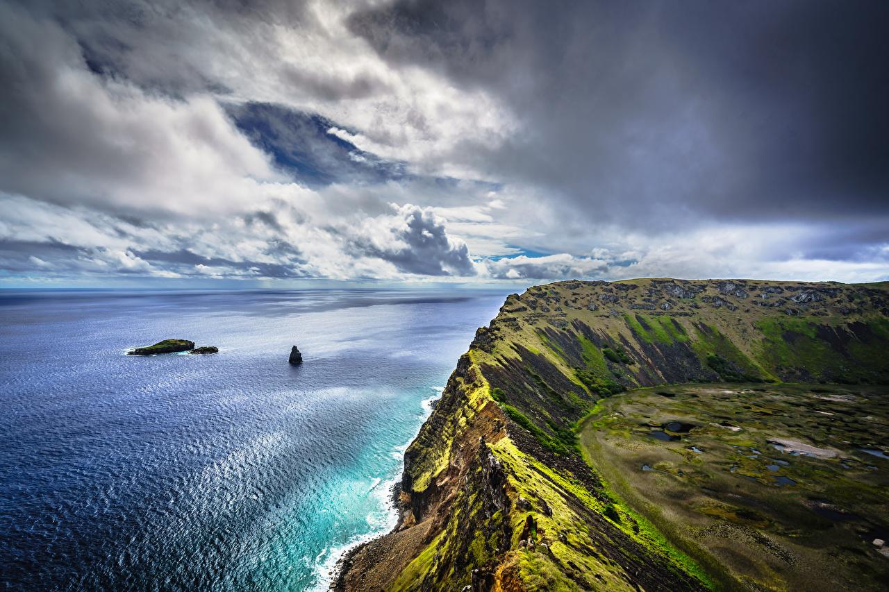Фото Чили Easter Island, Rano Kau Утес Природа Побережье облачно Скала скале скалы берег Облака облако