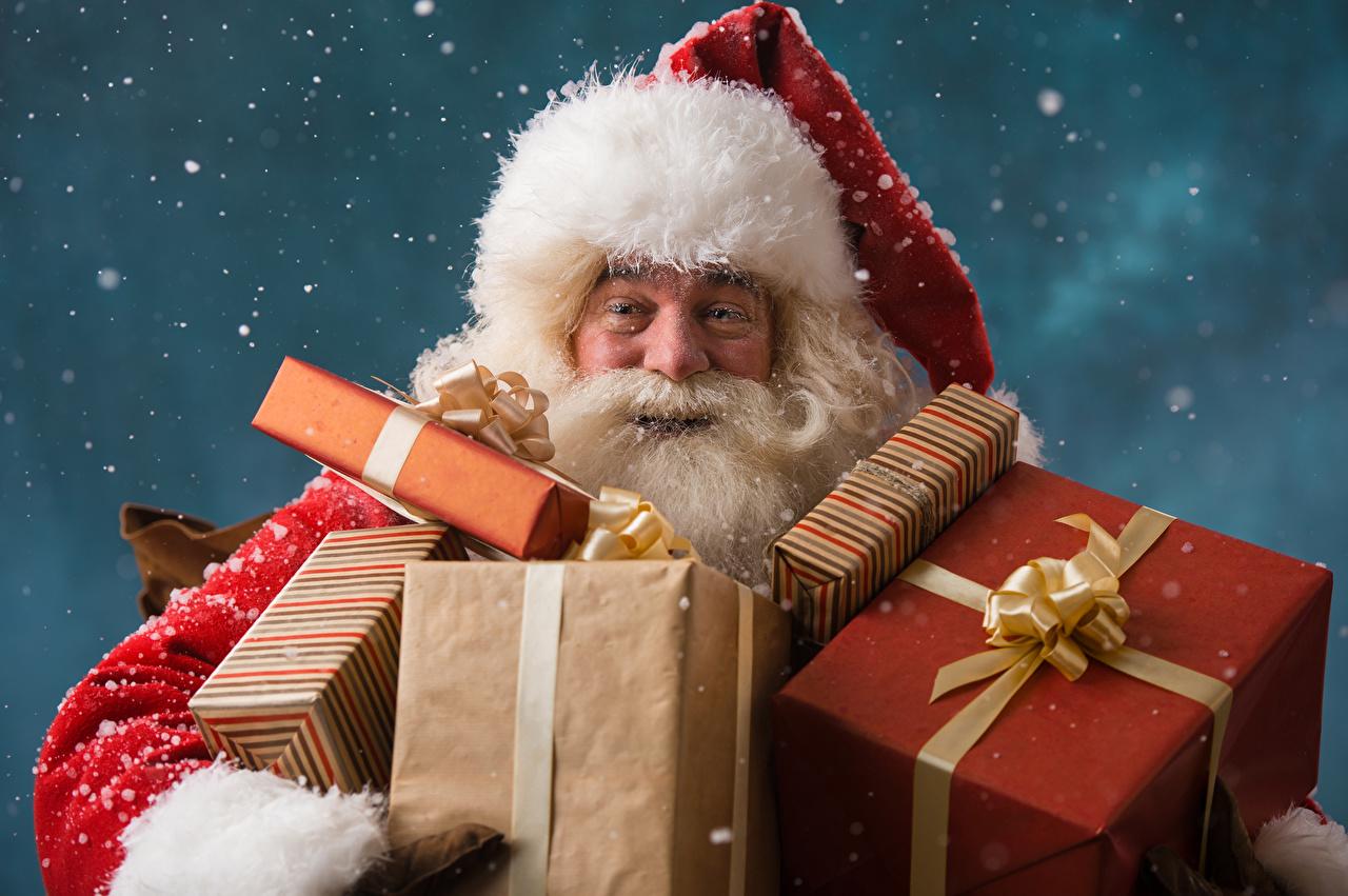 Картинка Новый год Шапки Санта-Клаус снега подарков Рождество шапка в шапке Дед Мороз Снег снеге снегу подарок Подарки