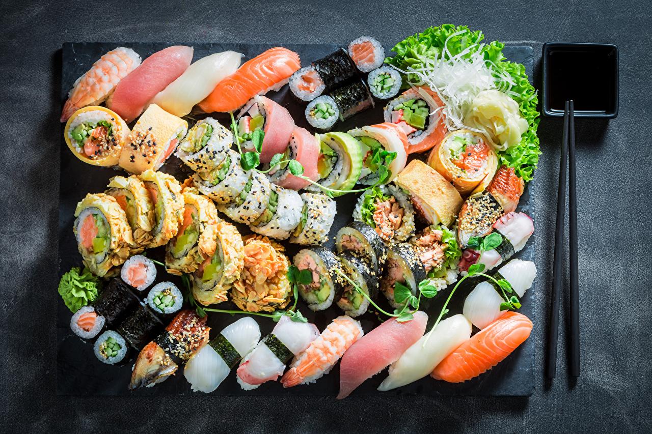 Картинка Рыба Суши Продукты питания Много Морепродукты суси Еда Пища