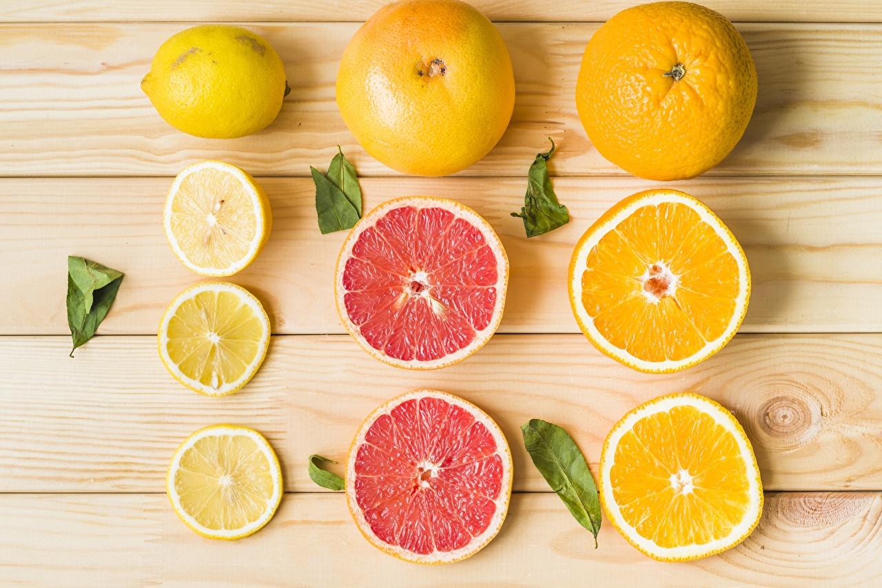 Картинка Апельсин Грейпфрут Лимоны Продукты питания Нарезанные продукты Доски Еда Пища нарезка