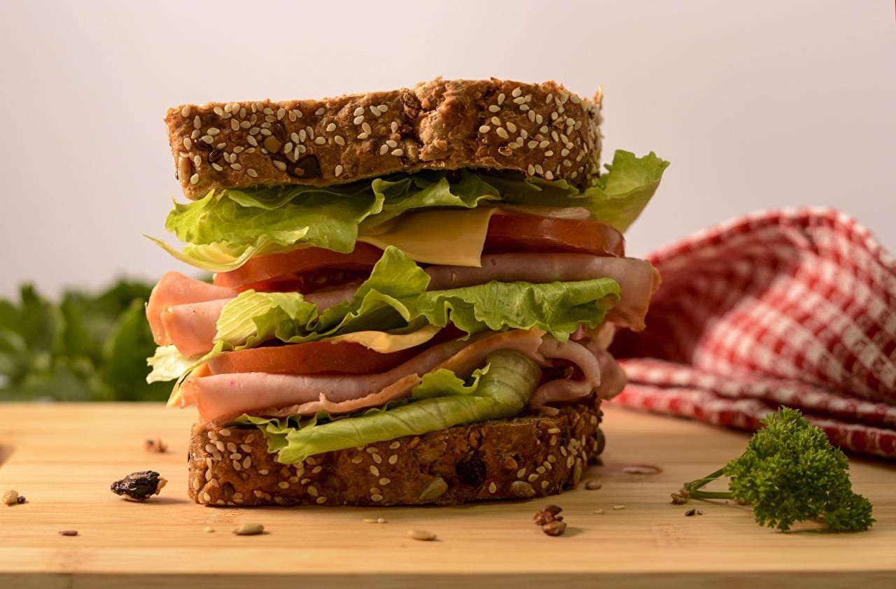 Фото Сэндвич Сыры Ветчина Продукты питания вблизи Еда Пища Крупным планом
