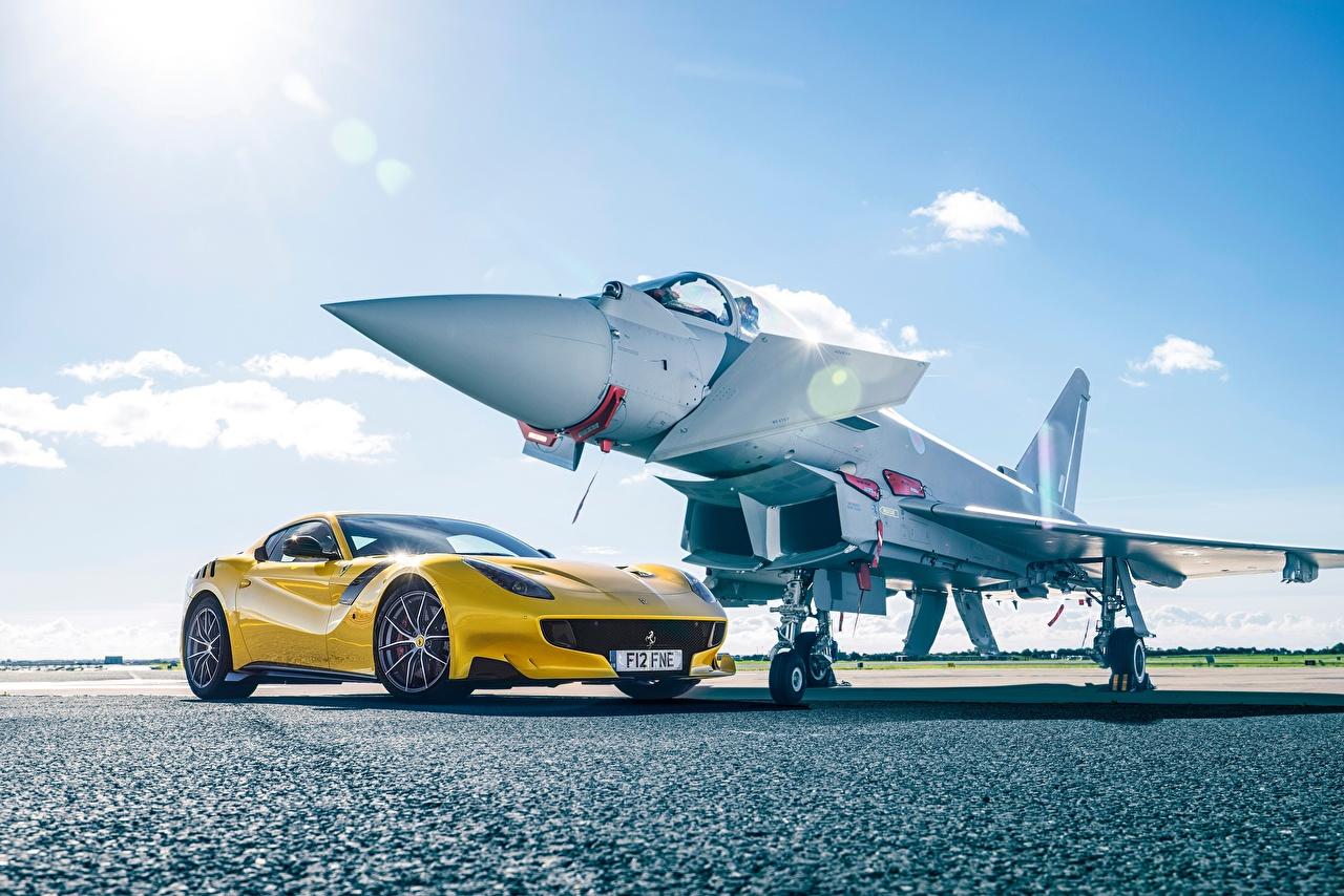 Обои Ferrari Истребители Самолеты f12 TDF желтая авто Феррари желтых желтые Желтый машина машины автомобиль Автомобили