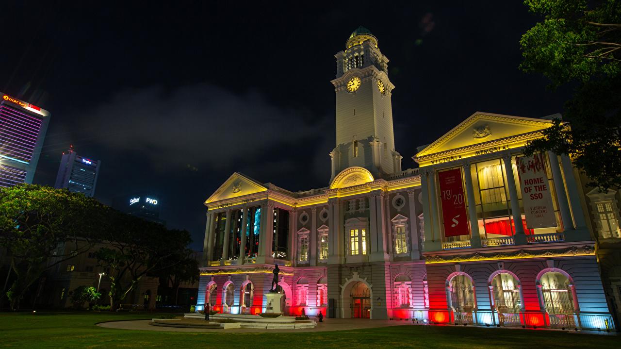 Картинка Сингапур Raffles Place Часы ночью Дома Города Ночь в ночи Ночные город Здания