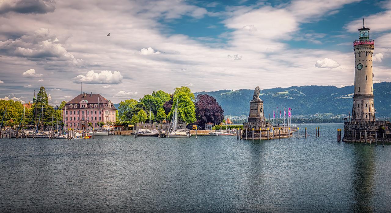 Картинки Бавария Германия Памятники Lindau маяк залива Причалы Дома Города Маяки Пирсы Залив заливы Пристань город Здания