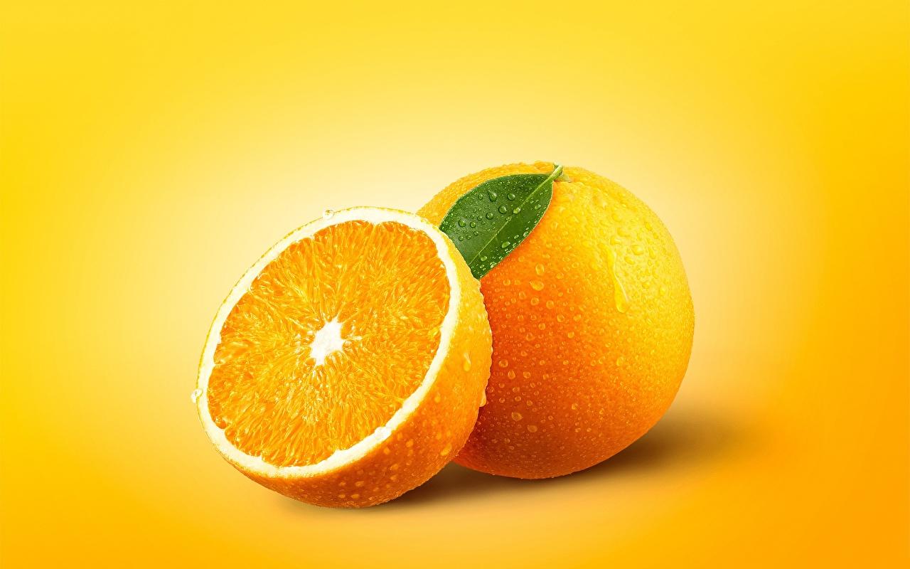 Фотография Апельсин капля Еда вблизи Цветной фон Капли капель капельки Пища Продукты питания Крупным планом
