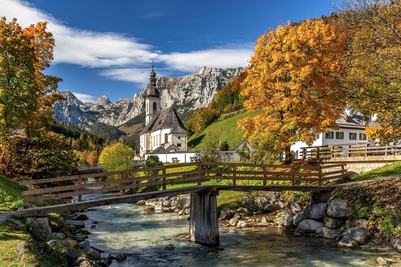 Фото Бавария Церковь Германия St. Sebastian, Ramsau мост гора Природа осенние Реки Горы Осень Мосты река речка