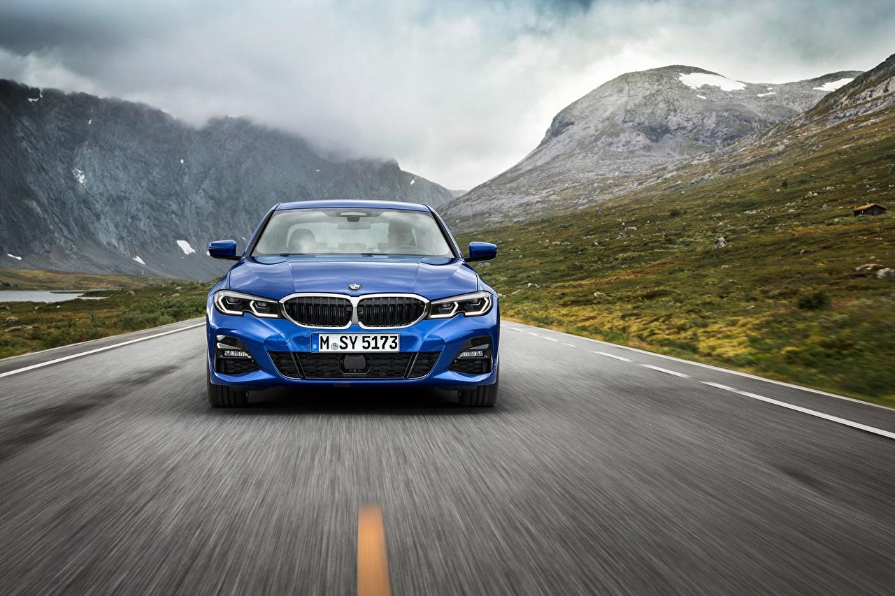 Фотографии БМВ 3-series M Sport G20 синие Движение авто Спереди BMW синяя Синий синих едет едущий едущая скорость машина машины Автомобили автомобиль